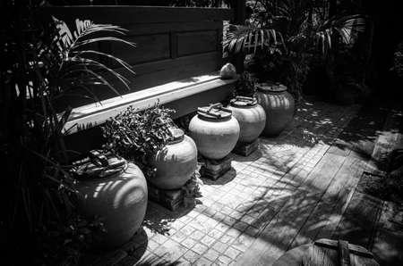 water black: Old jar of water black and white