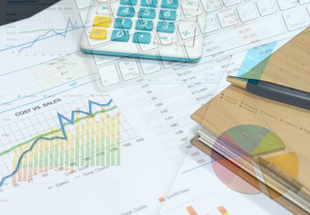 banking document: business documents with charts growth, keyboard and pen. workplace businessman