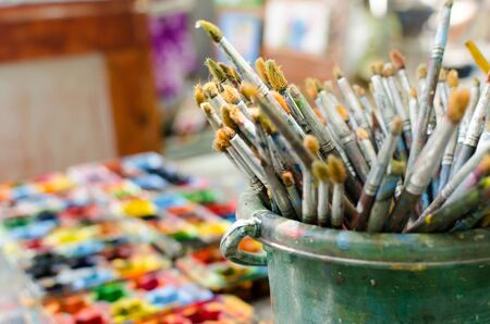 put together: Paint brushes put together on the table.