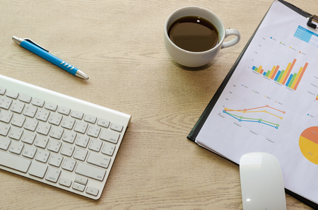 financial market: business documents with charts growth,coffee and pen. workplace businessman Stock Photo
