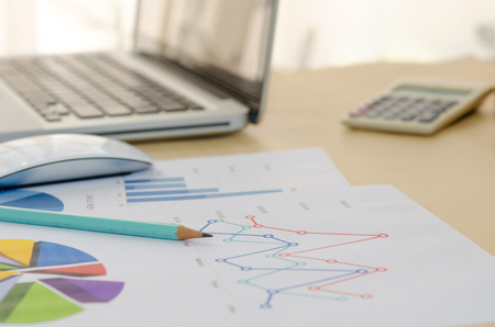 quarterly: business financial analysis with calculator Stock Photo