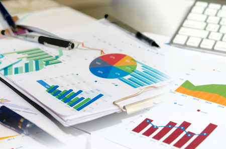 growth business: business documents with charts growth, keyboard and pen.  business concept Stock Photo