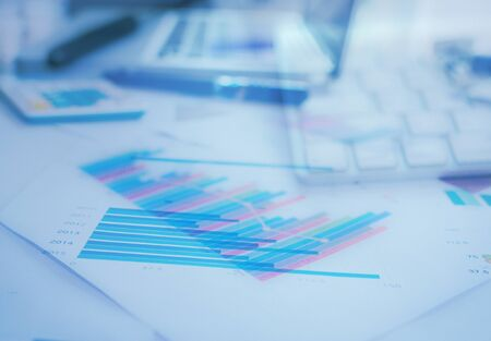 Graphs and charts, business table. The workplace of business people.Business Concept.A blue picture