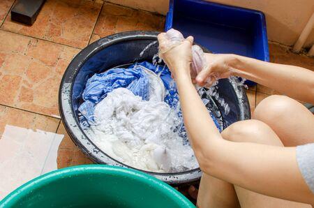 basins: Women washing clothes,the Washing plastic basins.