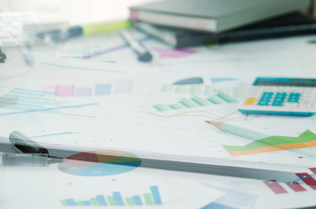 Financial paper charts and graphs on the table.style concept