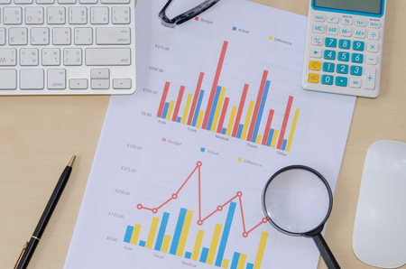 Documents, graphs on a desk. Stock Photo