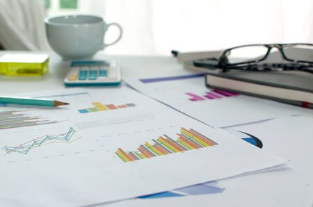 accounting: Business of financial analytics desktop with accounting charts and diagrams