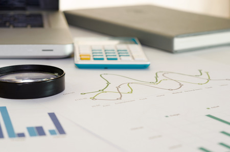 investment banking: business documents with charts growth.