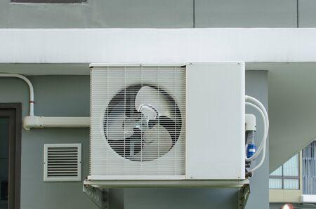 compressor: Air compressor installation on wall.