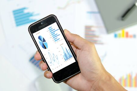 demonstrated: graphs and charts being demonstrated on the screen of a phone