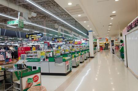 Supermarket store blur background ,Cashier counter with customer