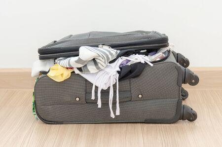 Open suitcase on floor in room.