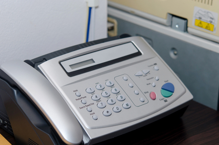office documents: Fax machine close up, office equipment