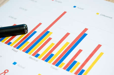 financial graph: Business graph of financial analytics and pen. Stock Photo