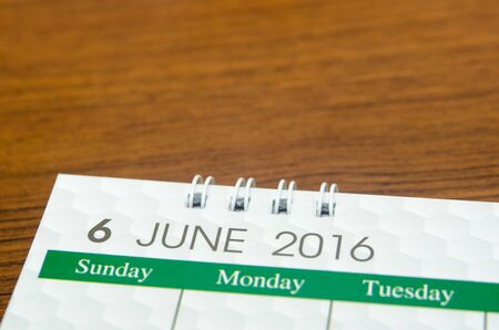 Close up calendar of June 2016 on table. Stock Photo