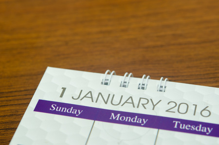 Close up calendar of January 2016 on table.