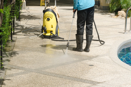 Outdoor floor cleaning with high pressure water jet Фото со стока - 61571771