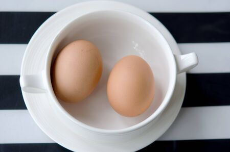 oiled: oiled eggs in a cup