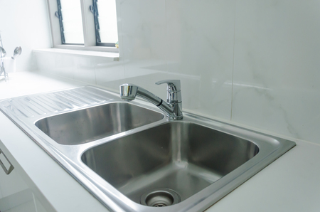 spotless: Water tap and sink in a modern kitchen. Stock Photo