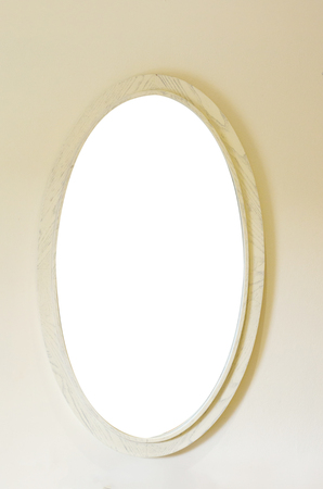 mirror frame: Mirror frame made of wood.