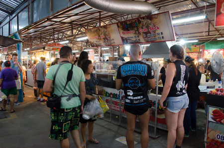 phuket food: PHUKET,THAILAND MARCH 12, 2016: Unidentified tourists shop at the night market of Phuket on Mar 12, 2016.serves as a market to the famous Phuket and is a major tourist hub.