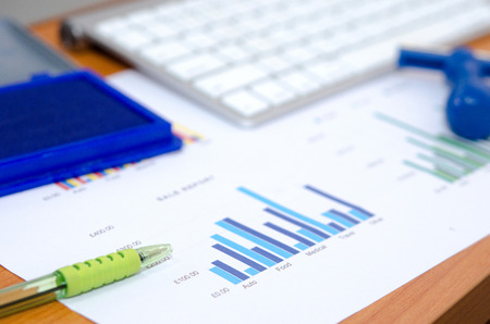 business documents with charts growth,keyboard.