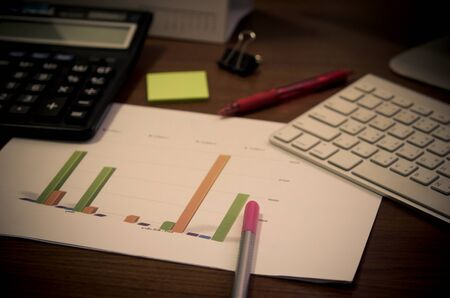 business documents on office table, financial with social network diagram and digital information.