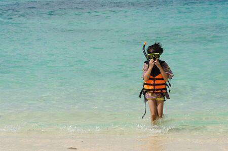 Children ocean beaches life jacket Stock Photo