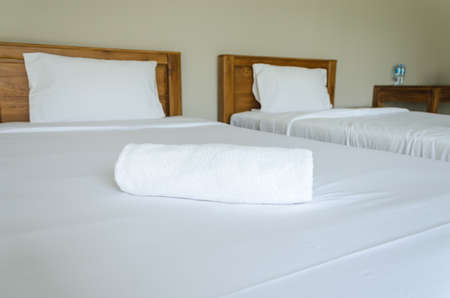 modern bathroom: White towel on the bed Stock Photo