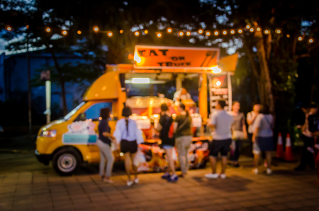 Abstract blur Festival food truck.as background , vintage tone.