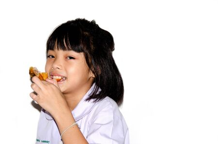 Girl eats chickens isolated on the white background,