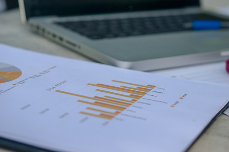 business Financial paper charts and laptop.