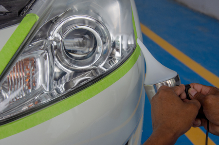 Polished car headlights using a steam engine.