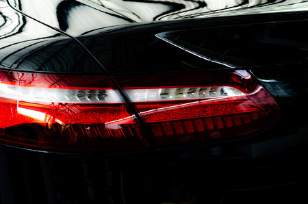 Luxury car tail light on a black background.