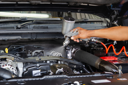 Car maintenance and checks coated engine cleaner cars.