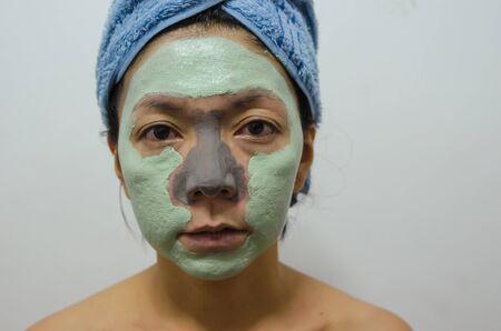 Asian women make beautiful facial skin with a facial mask.