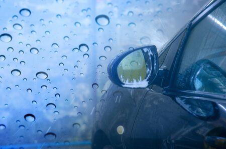 Car wash black with foam bubbles. copy space