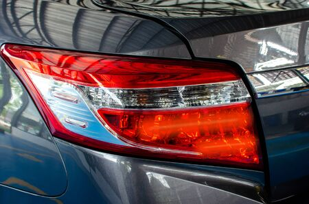 Close up to the taillights, gray cars.