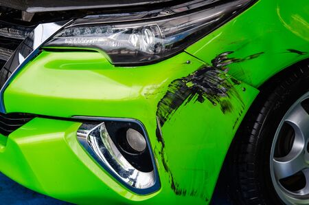 green car bump marks on the front bumper. Archivio Fotografico