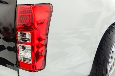 Modern detail on the rear light.The red rear light on the rear position lamp will work when the driver uses the cars brakes. Official lamps in standards and technical regulations Stock Photo