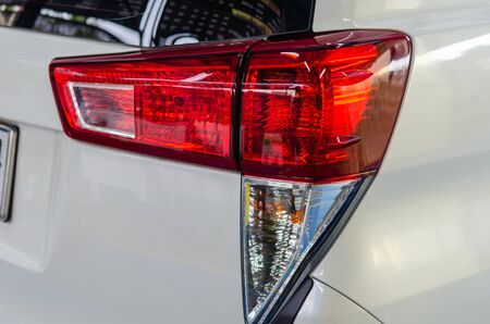 Modern detail on the rear light.The red rear light on the rear position lamp will work when the driver uses the car brakes. Official lamps in standards and technical regulations Banco de Imagens - 131813725