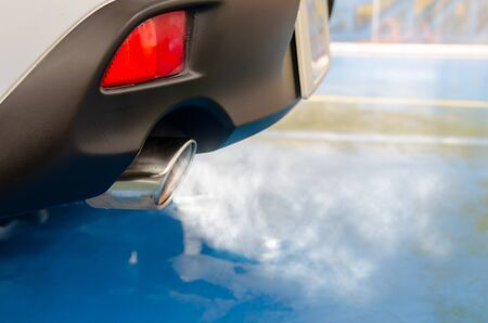 Car exhaust while leaving a smoke.