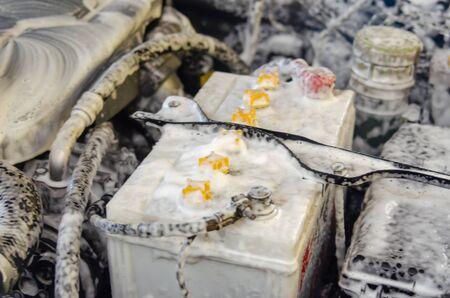 Wash the car battery by foam.
