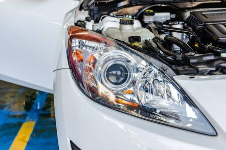 Car detailing - After polishing the car headlights. Stok Fotoğraf