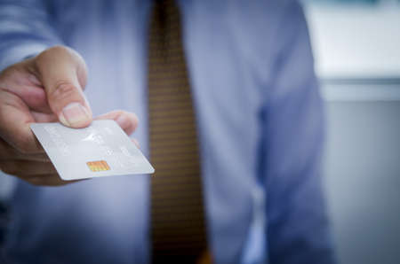 Men holding credit cards for online shopping and financial transactions.Credit card loan application