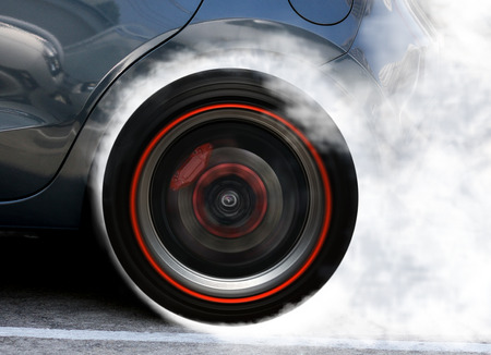 wheel spin: Super car wheel drifting and smoking on track