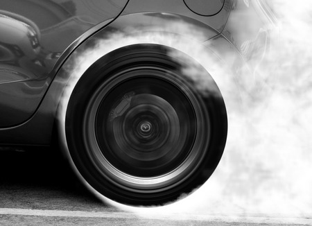 drifting: Super car wheel drifting and smoking on track with black and white color Stock Photo