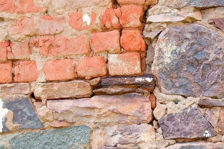 fixed: Rock wall fixed with bricks Stock Photo