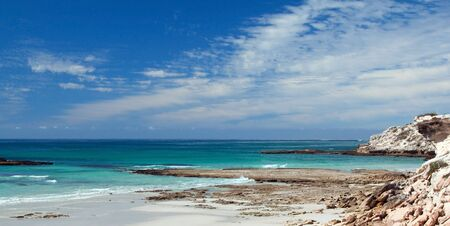 Panoramic of beach on a rocky coast with lovely turquoise water Stock Photo - 7142564