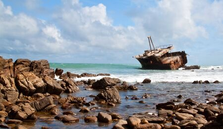Aghullas shipwreck lying on the rocks in the breakers photo